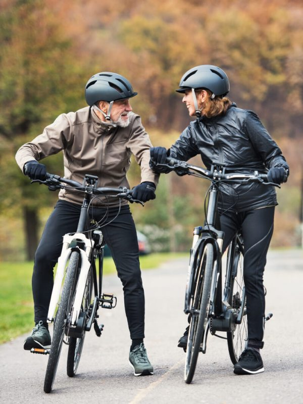 Ezy Bike Electric Bicycles Older couple on e-bikes in the outdoors